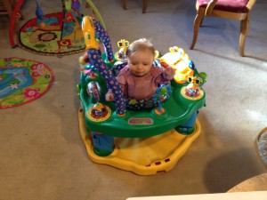 Amelia restrained in her Exer-saucer!